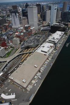 The Postal Service's massive facility on Fort Point Channel would be demolished to make way for the expansion of South Station if the state gets its way.
